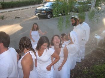 Jewish teens dressed in white.
